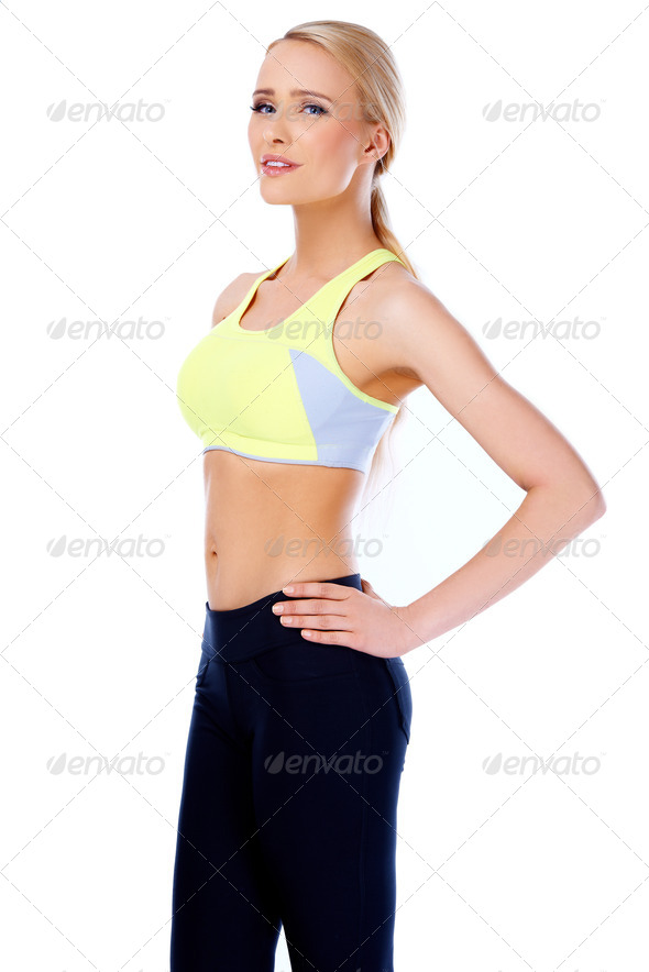 Sexy and slim blond woman standing on white - Stock Photo - Images