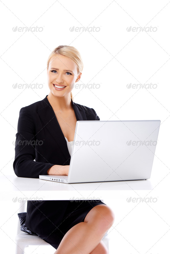 Smiling business woman using laptop computer - Stock Photo - Images