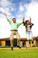 happy couple jumping of joy