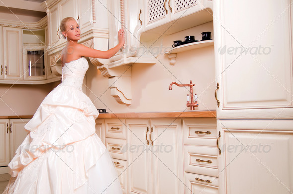PhotoDune bride stands in the kitchen 4205688
