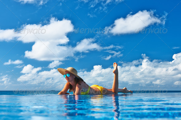 PhotoDune Woman at poolside 4229633
