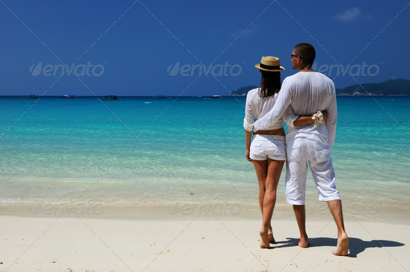 PhotoDune Couple in white on a beach 4229639