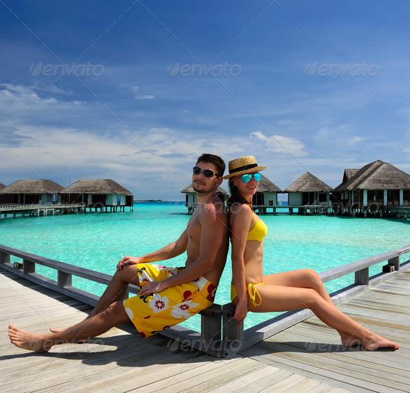 PhotoDune Couple on a beach jetty at Maldives 4229642