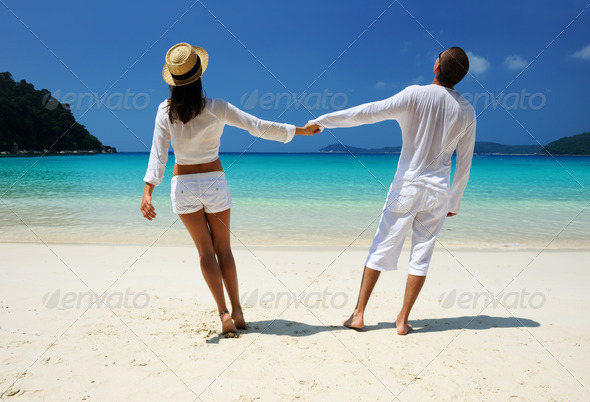PhotoDune Couple in white on a beach 4229645