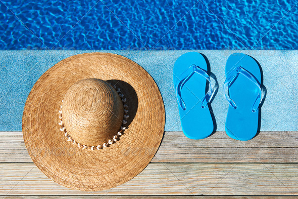 PhotoDune Blue slippers and hat by a swimming pool 4229674