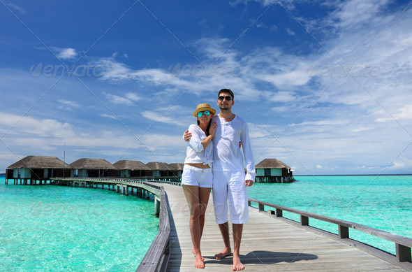 PhotoDune Couple on a beach jetty at Maldives 4229678