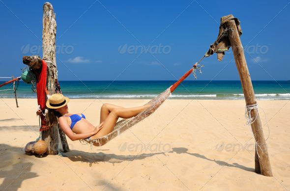 PhotoDune Woman in hammock on beach 4229685