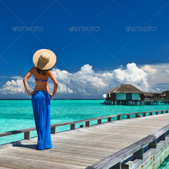 PhotoDune Woman on a beach jetty at Maldives 4229689