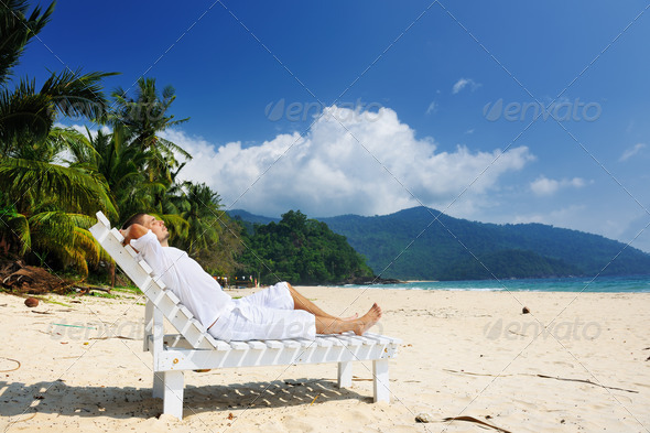 PhotoDune Man relaxing on a beach 4229690