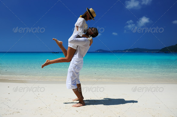 PhotoDune Couple in white on a beach 4229695