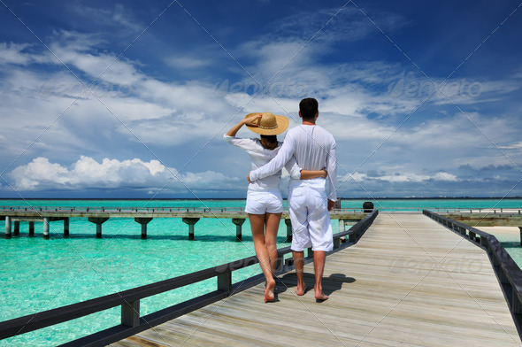 PhotoDune Couple on a beach jetty at Maldives 4229696