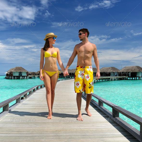 PhotoDune Couple on a beach jetty at Maldives 4229706