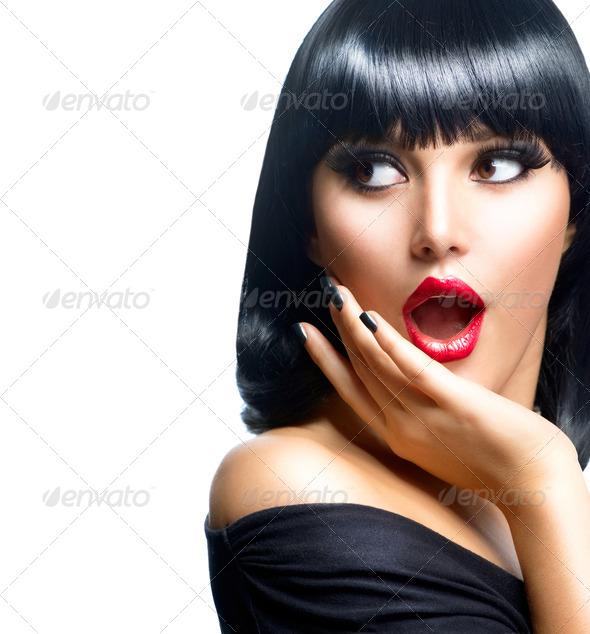 Beautiful Surprised Brunette Girl over White