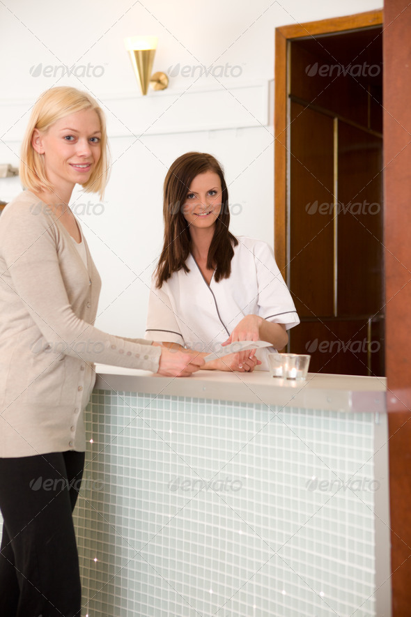 Woman in Spa Reception - Stock Photo - Images