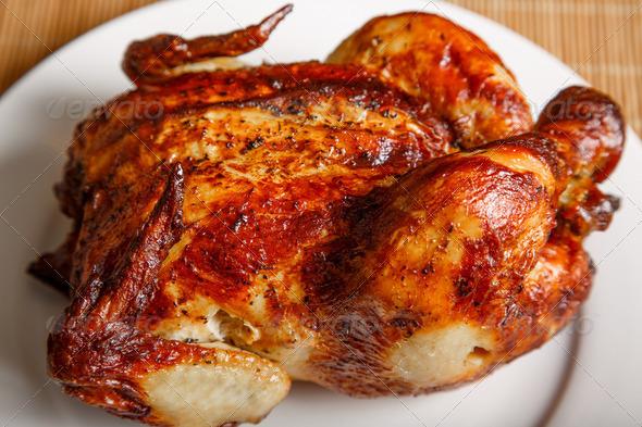 PhotoDune Whole Roast Chicken on White Plate 4254069