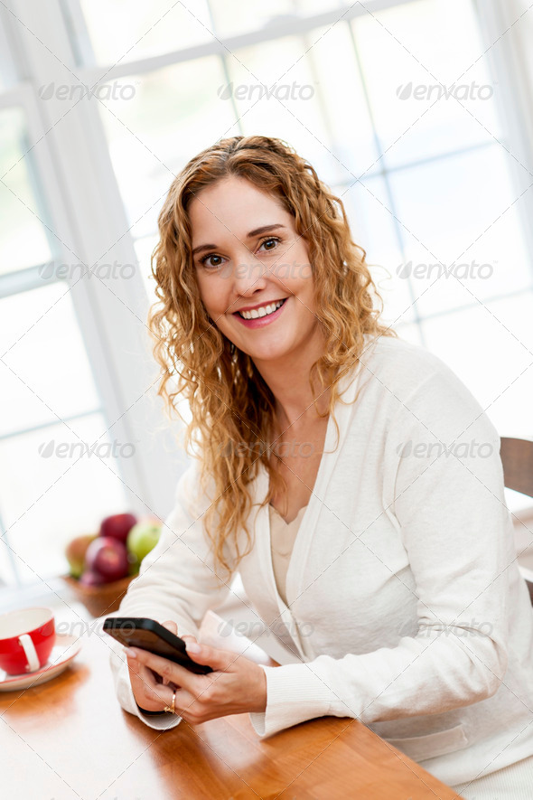 Smiling woman with smart phone - Stock Photo - Images