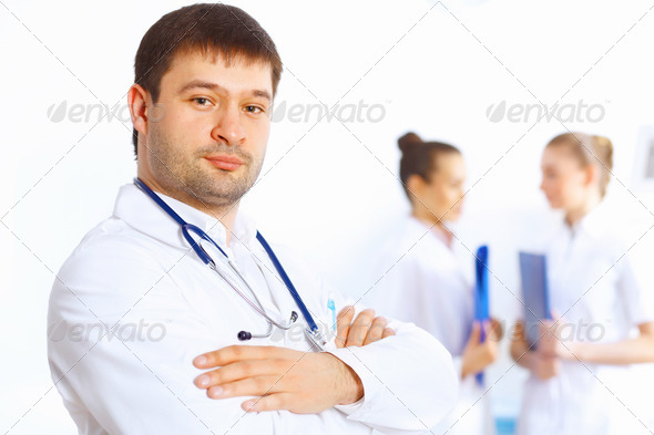 Young male doctor in white uniform - Stock Photo - Images