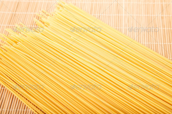 PhotoDune Dry Spaghetti on Bamboo Mat 4265871