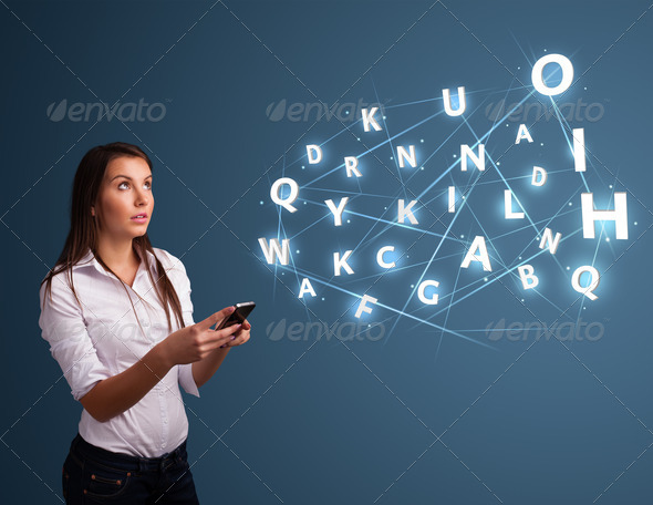 PhotoDune Young woman typing on smartphone with high tech 3D letters commi 4278502