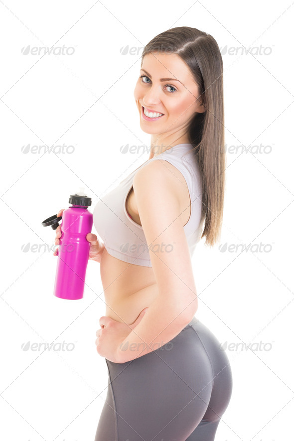 Attractive fitness girl refreshing after training - Stock Photo - Images