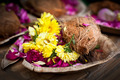 Flower and coconut offerings for Hindu religious ceremony