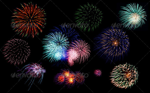 Colorful fireworks of various colors in night sky - Stock Photo - Images