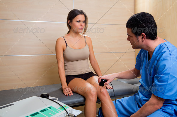 Ultrasonic therapy machine treatment doctor and woman - Stock Photo - Images