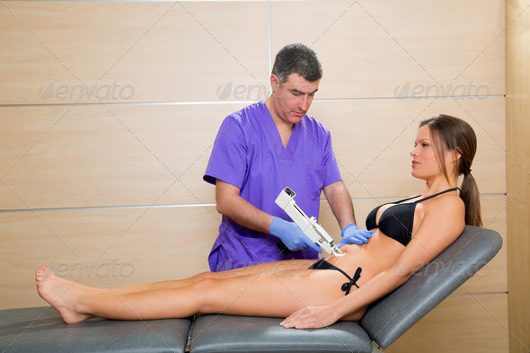 abdominal mesotherapy gun therapy doctor to woman - Stock Photo - Images