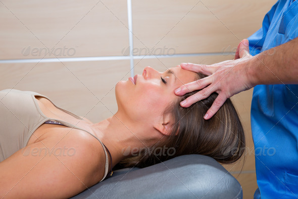 facial massage relaxing theraphy on woman face - Stock Photo - Images