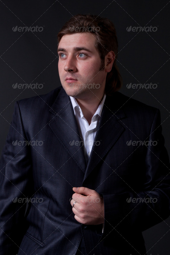 PhotoDune man in a black suit with a gray background 4307249