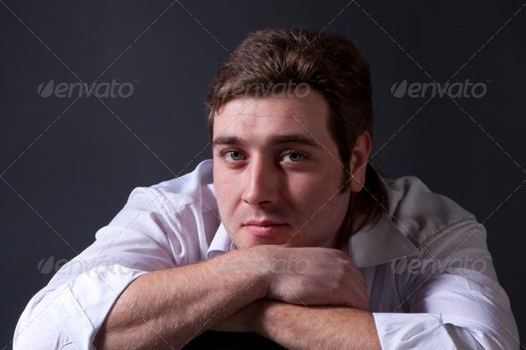 PhotoDune man posing in white shirt on dark background 4307250