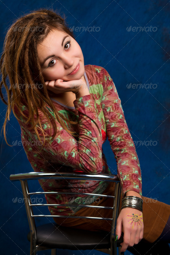 PhotoDune portrait woman with dreadlocks against a blue background 4307588