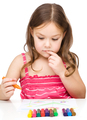 Little girl is drawing using colorful crayons - PhotoDune Item for Sale