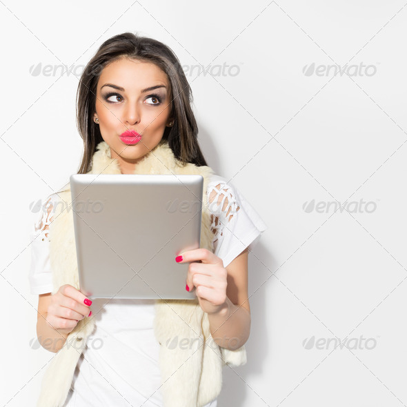 Young hipster brunette woman using digital tablet - Stock Photo - Images