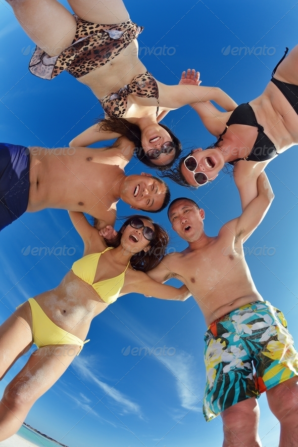 group of happy young people have fun on bach - Stock Photo - Images