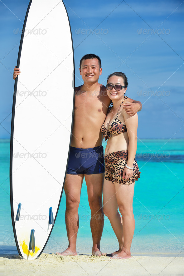 happy young  couple enjoying summer on beach - Stock Photo - Images