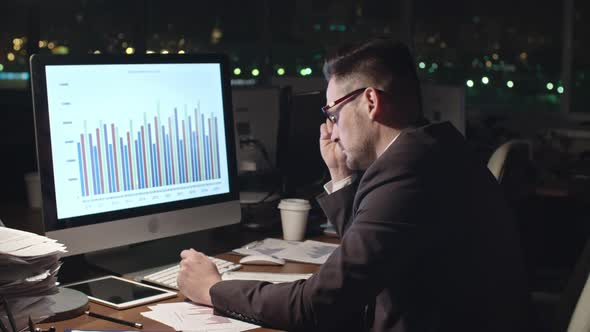 Download Tired Businessman Working Late at Night nulled download