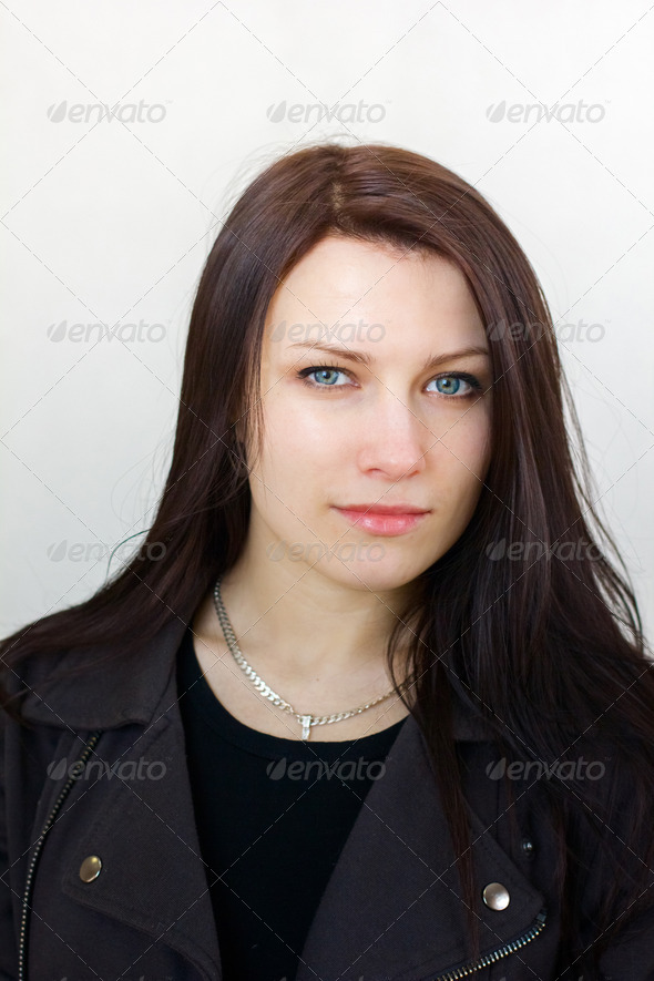 portrait of a beautiful serious brunette girl with long hair - Stock Photo - Images