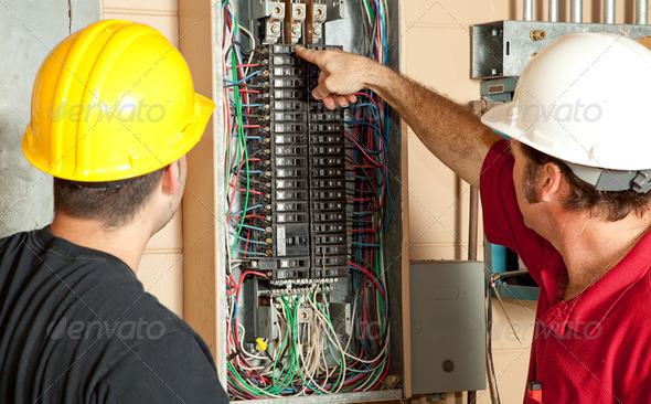 PhotoDune Electricians Replace 20 Amp Breaker 465870