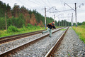 Elderly man crosses a railway embankment - PhotoDune Item for Sale