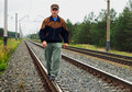 An elderly man walking on tracks - PhotoDune Item for Sale