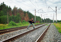 An elderly man crosses a railway embankment - PhotoDune Item for Sale