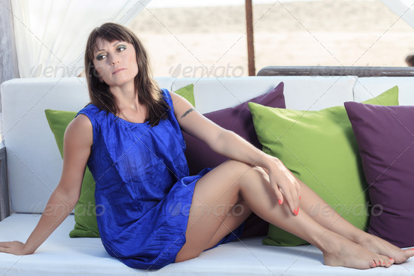 woman sits back relaxed - Stock Photo - Images