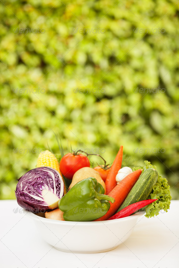 Vegetable in a White Plate. Over Nature Background - Stock Photo - Images