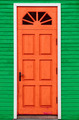 Red vintage wooden door and green wall - PhotoDune Item for Sale