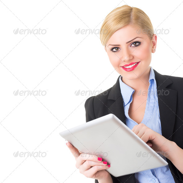 Beautiful blonde businesswoman using digital tablet - Stock Photo - Images