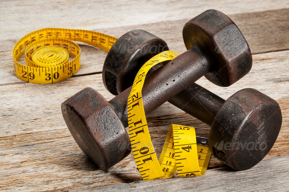 iron dumbbells and measuring tape - Stock Photo - Images