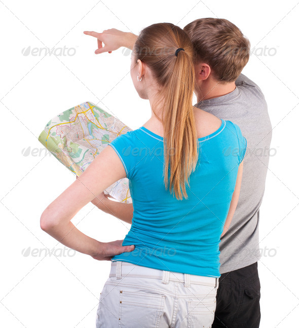 Back view journey of the young couple looking at the map - Stock Photo - Images