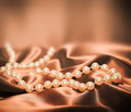 Pearls on a silk fabric background - PhotoDune Item for Sale