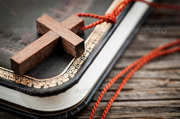 Cross on Bible - Stock Photo - Images